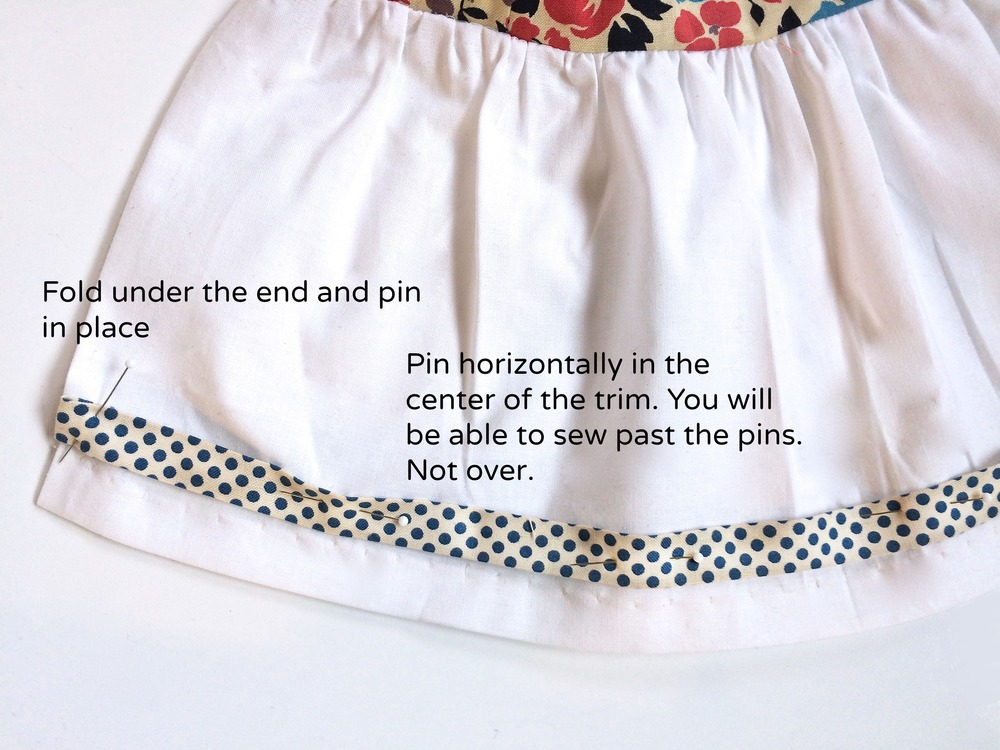 Pinning your trim so you can sew.