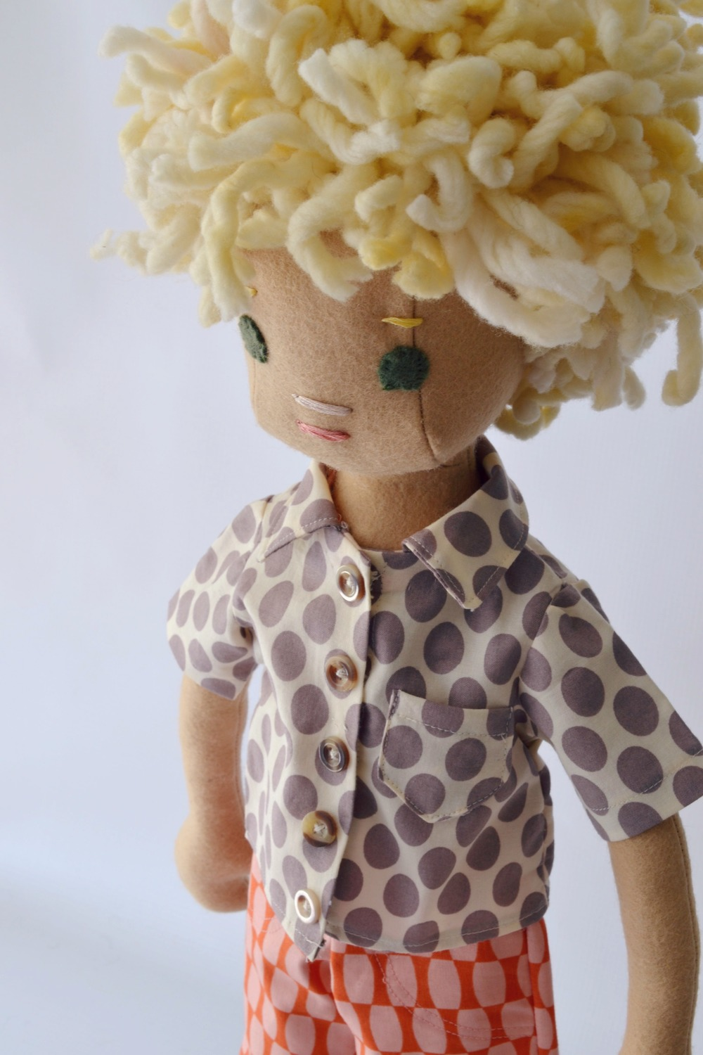 A new boy doll with a bit of bedhead--typical boy