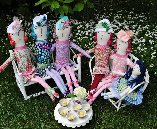 The Garden Party Girl Dolls doing what they do best