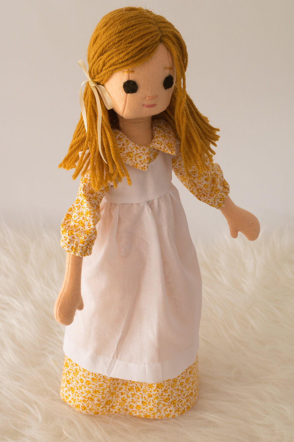 ExtraSmall Phoebe wears a prairie dress made from Little House on the Prairie fabric.