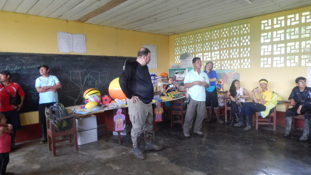 Donating school supplies to a local village