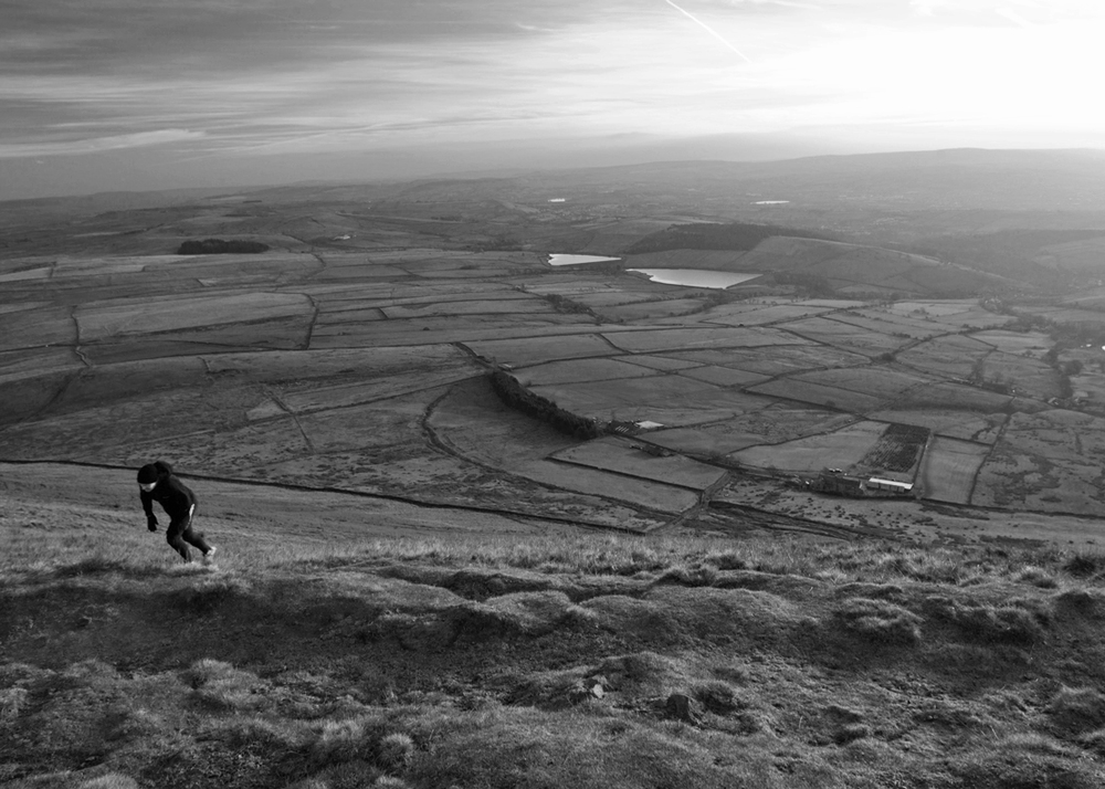 A fell runner reaches Pendle summit the hard way, straight up the Pendleside slope.