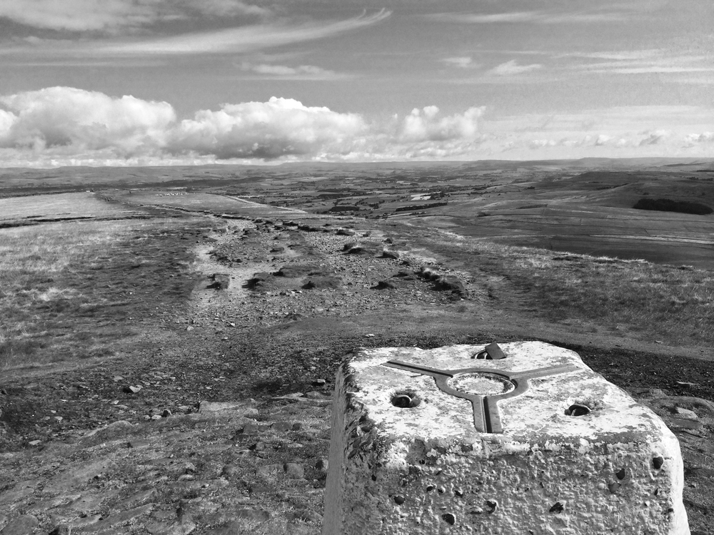 Pendle Hill summit trig point looking north into North Yorkshire