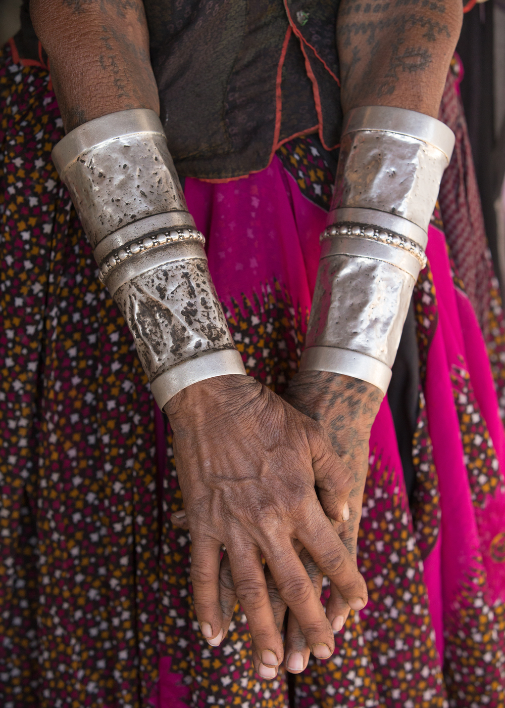 Leeloo, a village lady from near Zainabad comes from Rajasthan. These are her marriage bands.