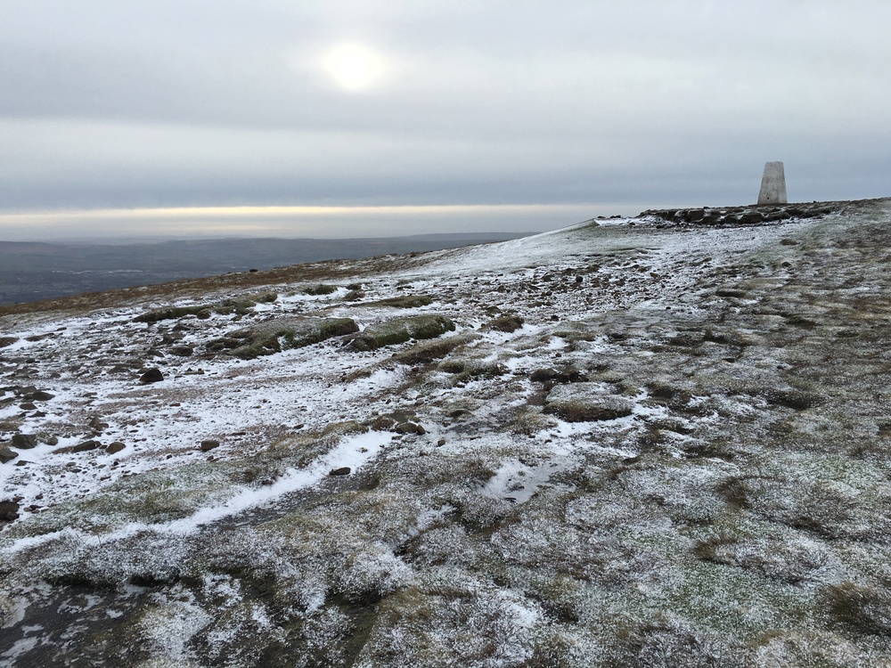 A frozen Pendle summit.