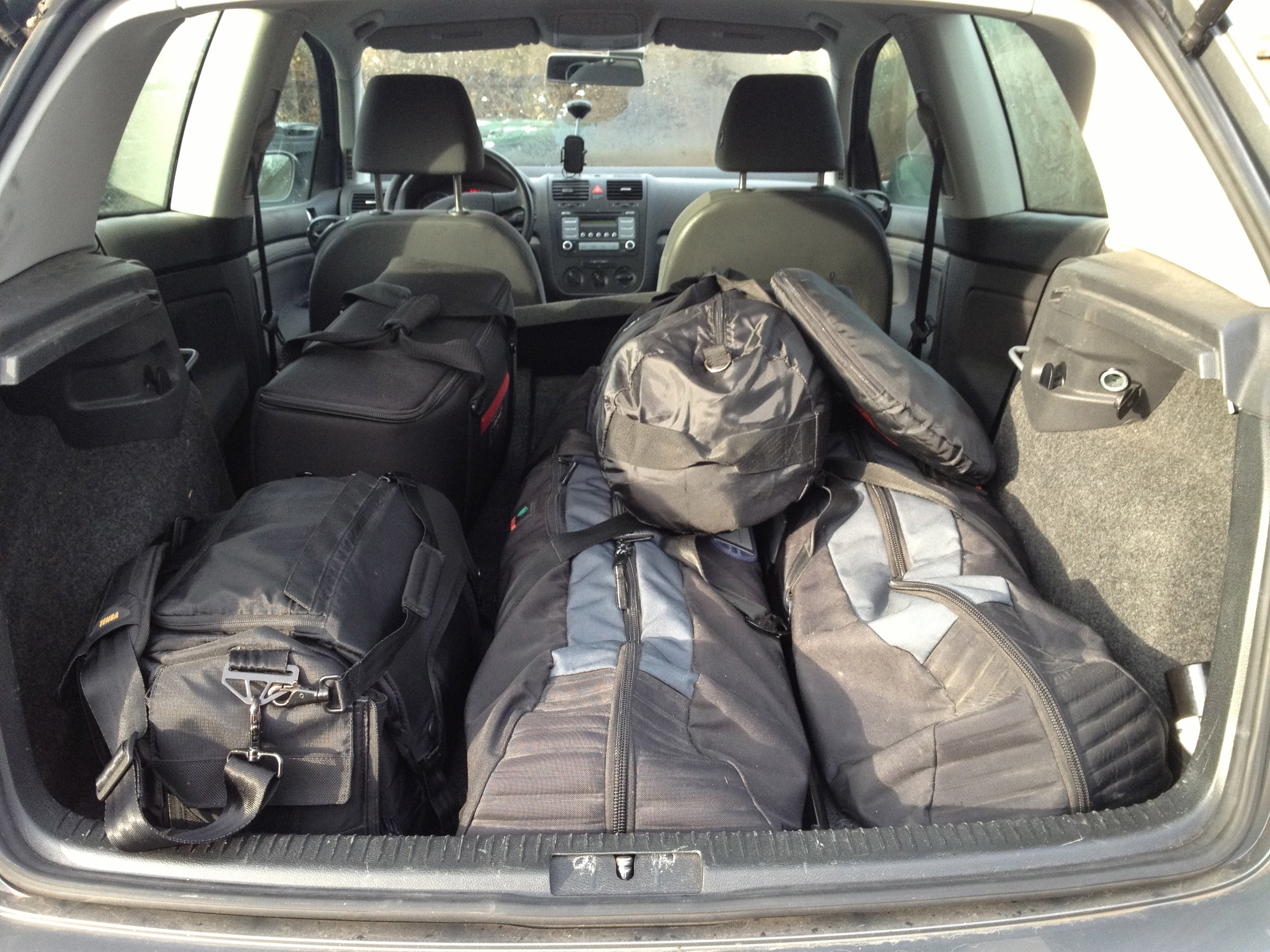 A medium amount of gear loaded into the Golf, leaving barely enough space for a photographer and an assistant