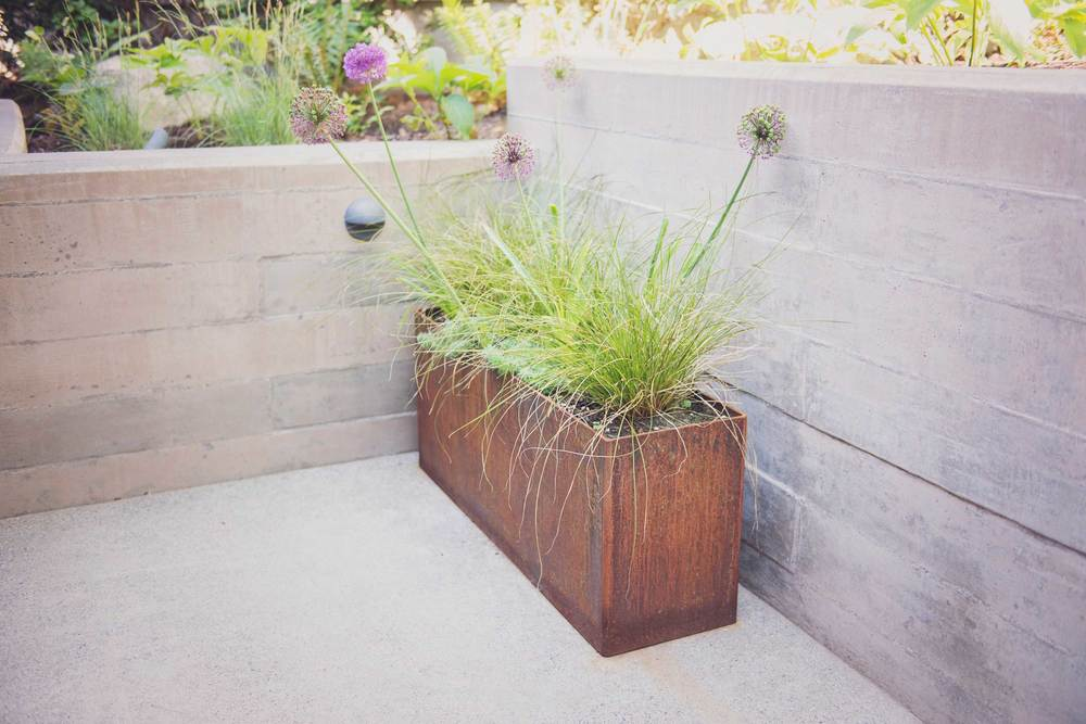 Board-Formed Concrete Retaining Wall and COR-TEN Planter