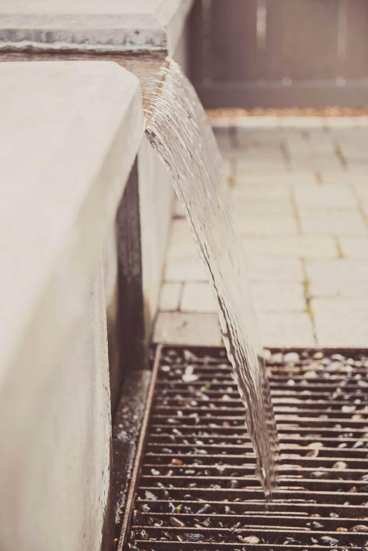 Subtle Concrete + Steel Weir Water Feature