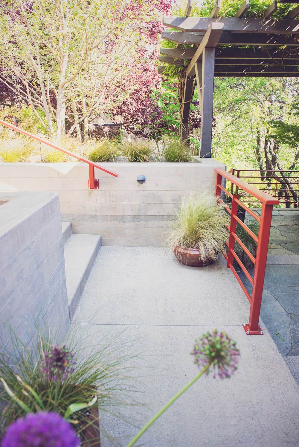 Board-Formed Concrete Retaining Wall Design and Modern Steel Railings at an Ashland Home.jpg