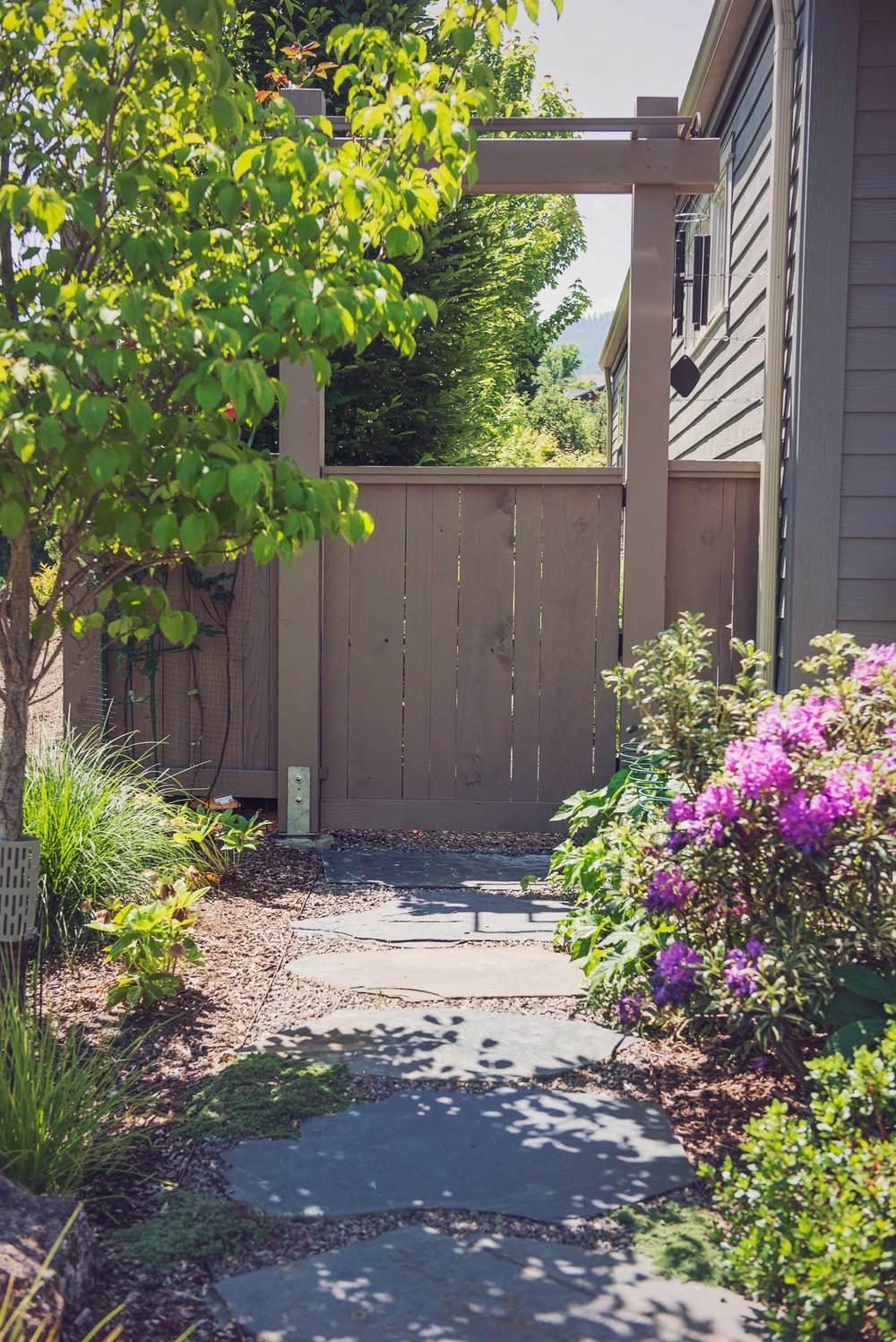 Garden Gate Design with Cedar Privacy Slats and Ornamental Arbor.jpg