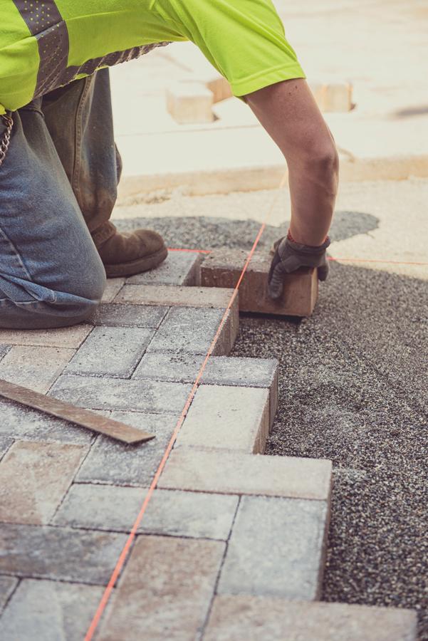 Regenesis Field Crew Installing a Concrete Paveer Patio.jpg