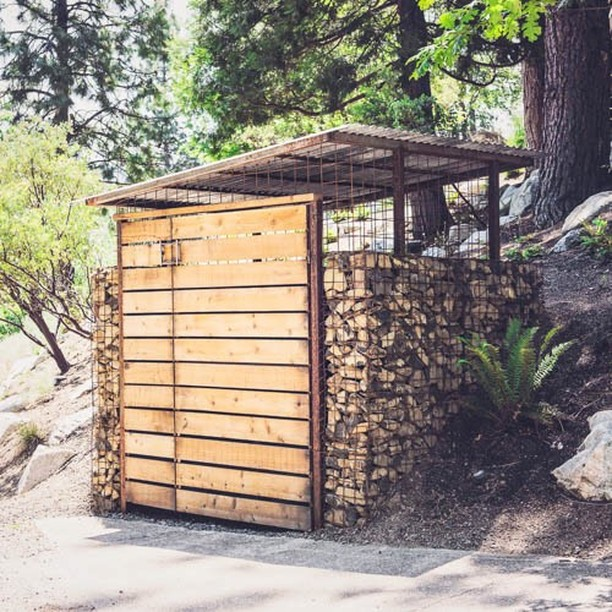 Tfw 🐻 keeps getting into your recycling... Steel-framed basalt #gabionwalls w/ #westernredcedar slat double-swing doors fit the trash can too.