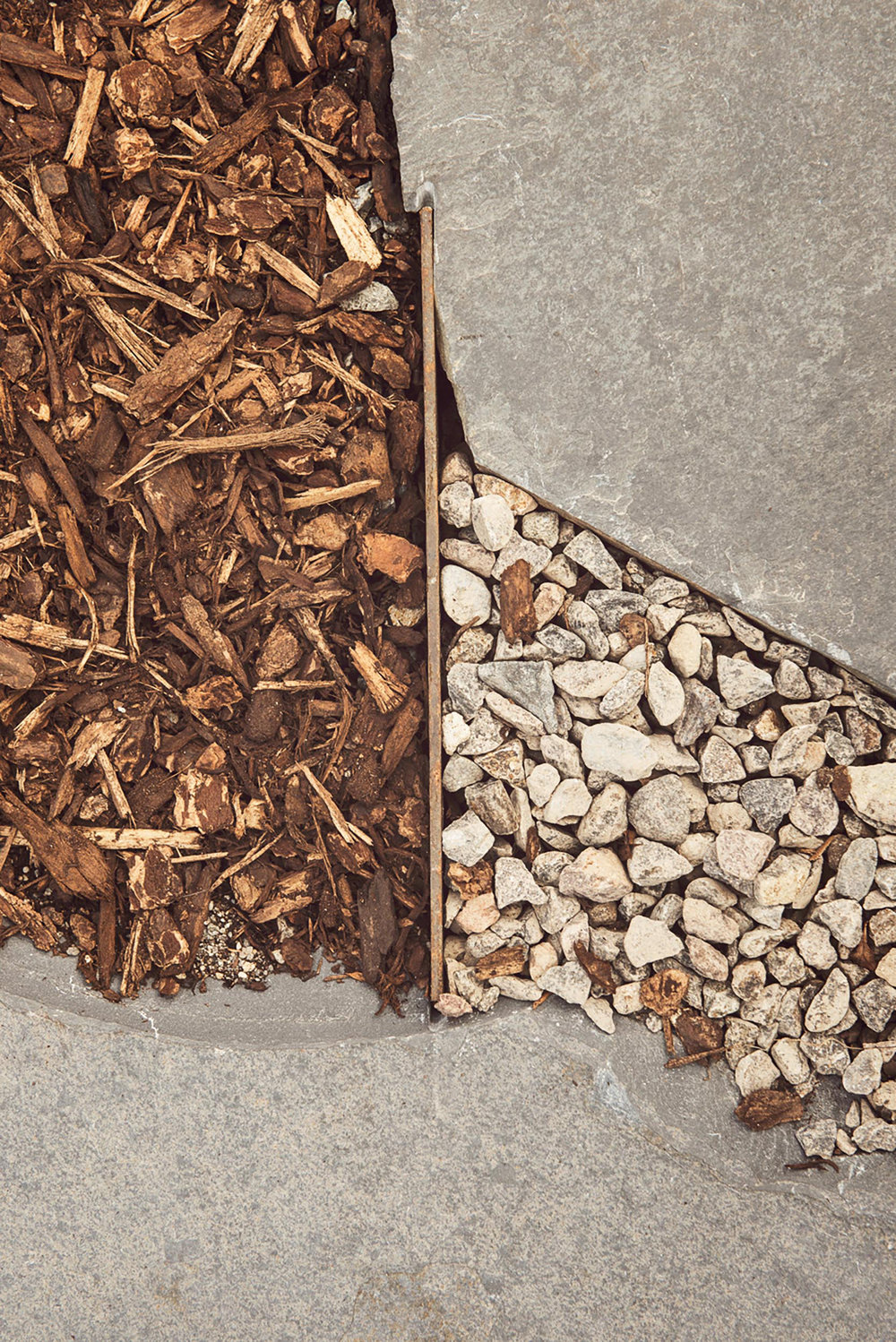 mulch meets crushed gravel + flagstone close up + landscape materials art shot