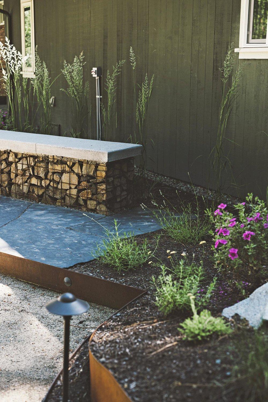 gabion and concrete bench seat + flagstone patio + grasses + side view + hardscape materials landscape + low maitenance