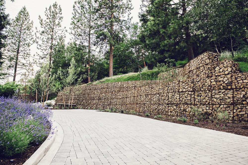 Large Gabian retaining wall system + terraced gabion walls + lavender curb appeal +permeable paver drive + modern PNW landscape + local resources
