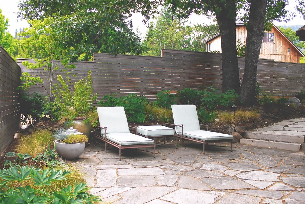 Flagstone Patio + Timber + Gravel Steps + Horizontal Cedar Slat Privacy Fence + Deer-Resistant Perennial Garden + Modern + Seating Area