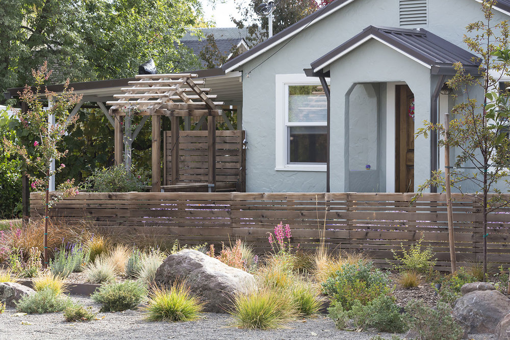 Short Cedar Fence + Arbor + Drought-Tolerant Vibrant Garden