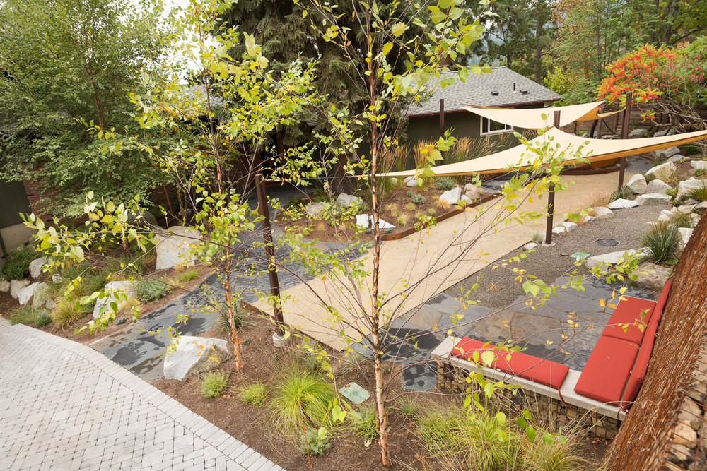 Flagstone Entrance + Bocce Court + Outdoor Living