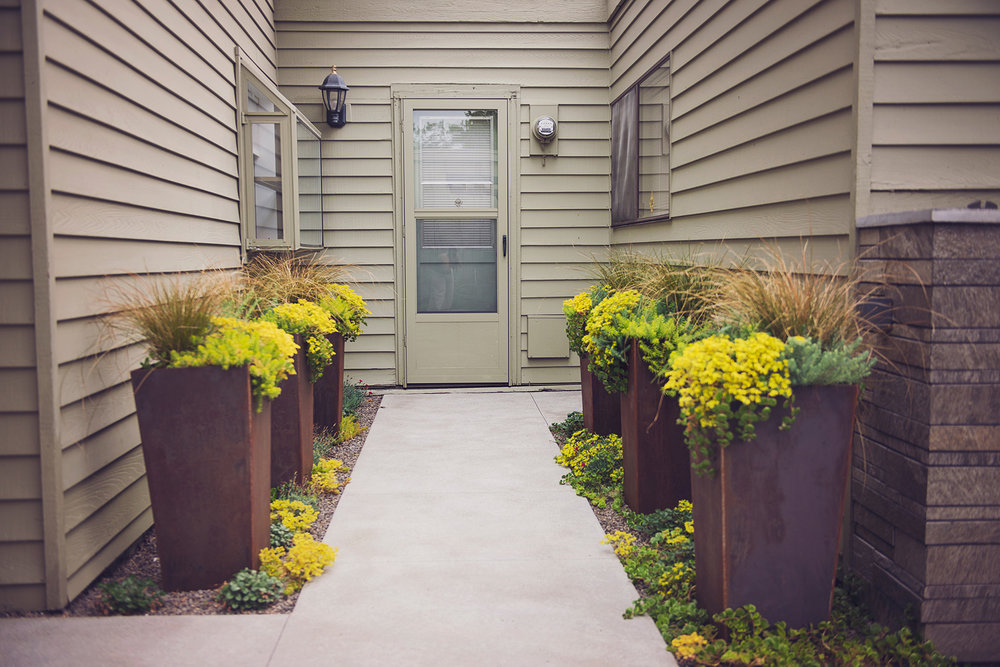Compact Concrete Courtyard + COR-TEN Planters + Sedums