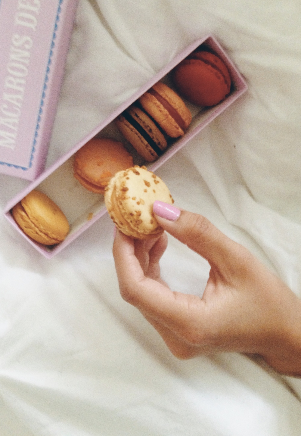 Macaroons in bed. I almost want to vom at this cliche, blogger moment.