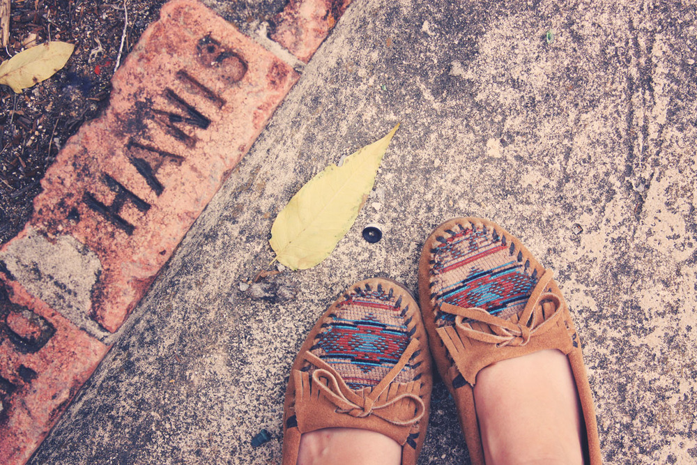 minnetonka moccasins on roots and feathers.jpg