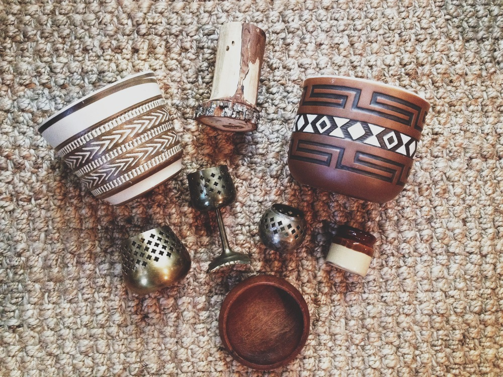 Had an amazing thrift score the other day!  This was all from the same store and was all under $15.  Those planter pots are just about the coolest ones Ive ever seen.  The top wooden thing is handmade and has the artists name burned on the bottom.  I'm assuming its a utensil holder, but I'm sure it will get filled up with incense, feathers or others things of that nature.  And I'm a sucker for old punched brass.  I love the way candles flicker through them.  And old wooden bowls.  I have... alot of weaknesses.