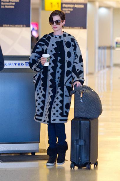 Anne Hathaway - JFK Airport - Splashnews