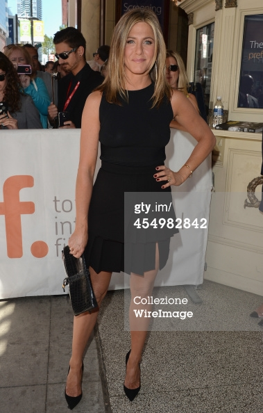 Jennifer Aniston carrying Salvatore Ferragamo clutch.jpg