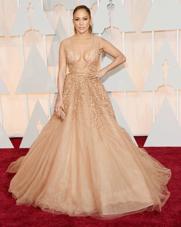 Jennifer Lopezon in sparkly Elie Saab Couture ballgown, holding a Salvatore Ferragamo clutch