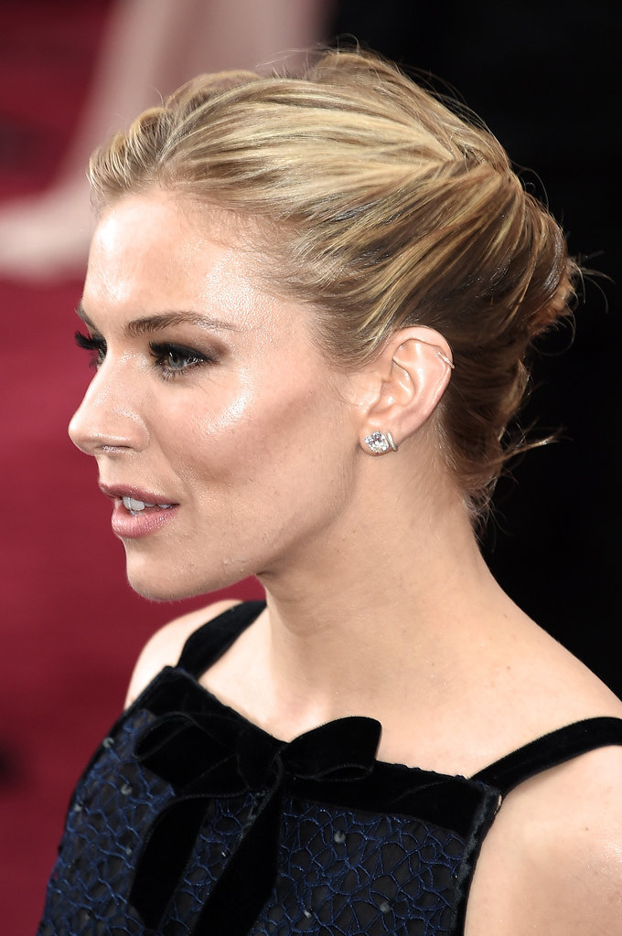 Sienna Miller went for a unique twisted style updo. Source:  www.popsugar.com  & Source:     Getty / Ethan Miller