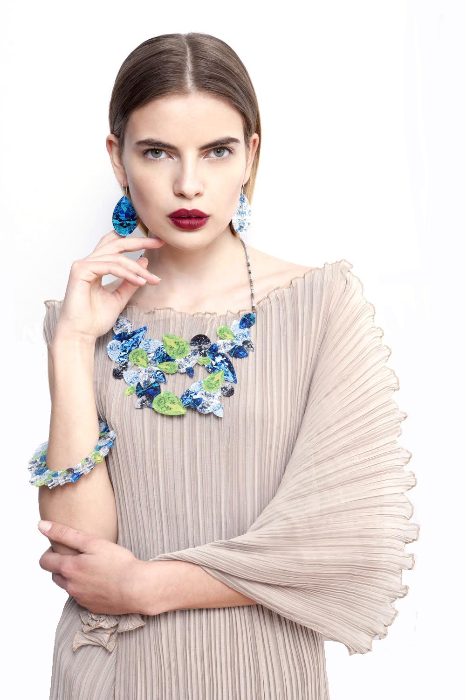 Cascading pleated dress & Trompe l'oeil jewelry.jpg