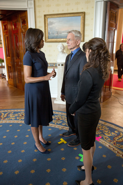 First Lady Michelle Obama participates in an NCIS taping in support of Joining Forces with Mark Harmon and Reiko Aylesworth in the Blue Room of the White House, April 11, 2016. (Official White House Photo by Lawrence Jackson)