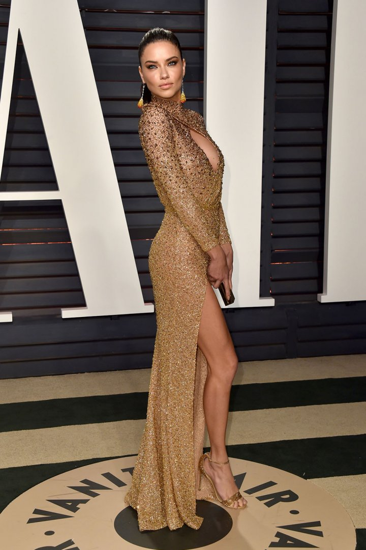 Adriana Lima in a gold Labourjoisie dress at the 2017 Vanity Fair Oscar Party.  Photo by Getty Images