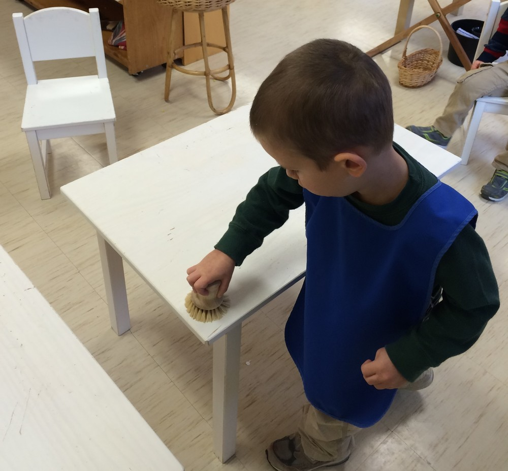 Table scrubbing is a work that uses a child's gross motor skills. While scrubbing the table from left to right (the way we read a book) a child is sometimes heard singing while they are working. Who says table scrubbing cannot be fun!