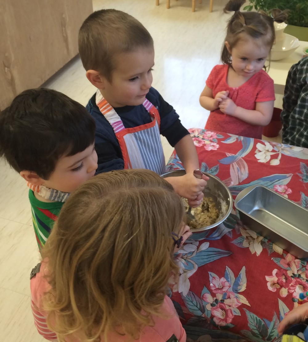 Baking in the Montessori environment utilizes math, reading, and science skills. Who doesn't love to demonstrate their culinary skills to others. The specialty of the day is banana bread.