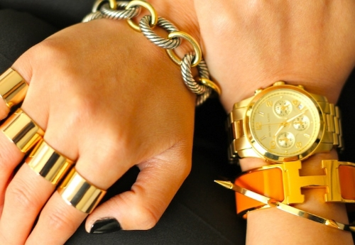 Hermes, David Yurman, Jules Smith bracelets, Michael Kors watch, Maison Martin Margiela rings