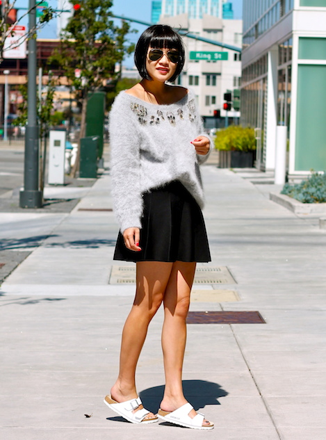 Club Monaco sweater and skirt, Birkenstock sandals, Ray-Ban sunglasses