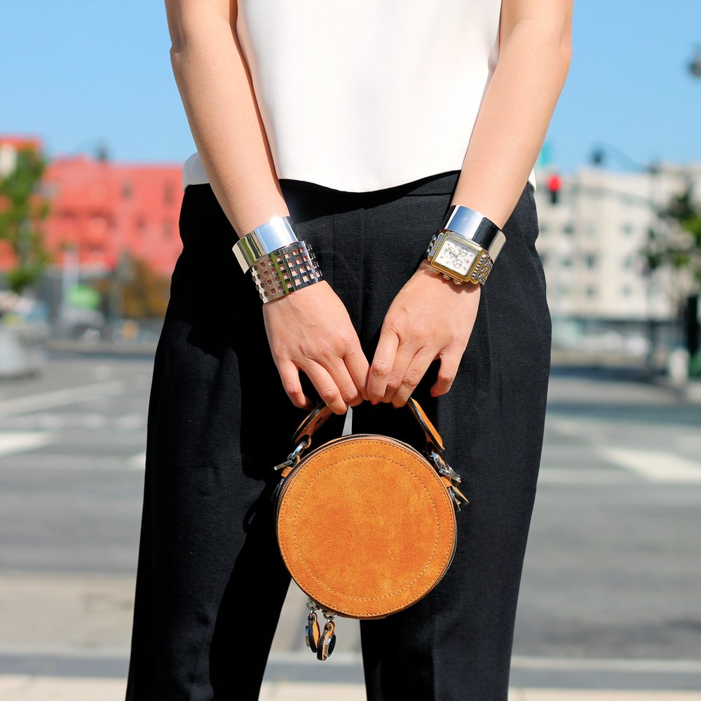 Svelte Metals cuffs, Michele watch, Carven bag