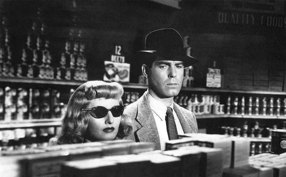 "Barbara Stanwyck (in that awful wig) and Fred MacMurray in ""Double Indemnity"""