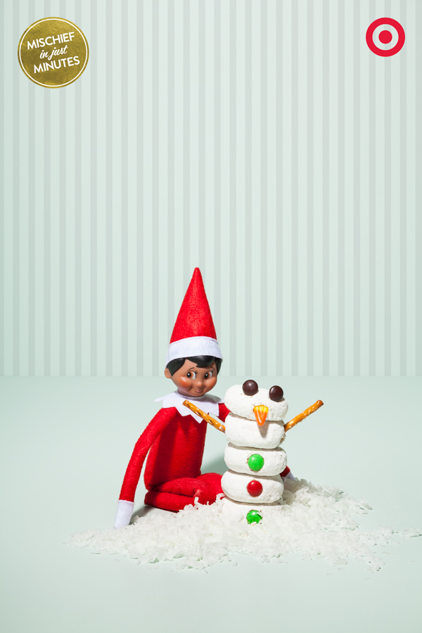 Christmas means that there's no shortage of snacks around the house. So it makes sense that an energetic elf snagged mini-powdered donuts, pretzels sticks and candy to build a Snack-tastic holiday snowman.
