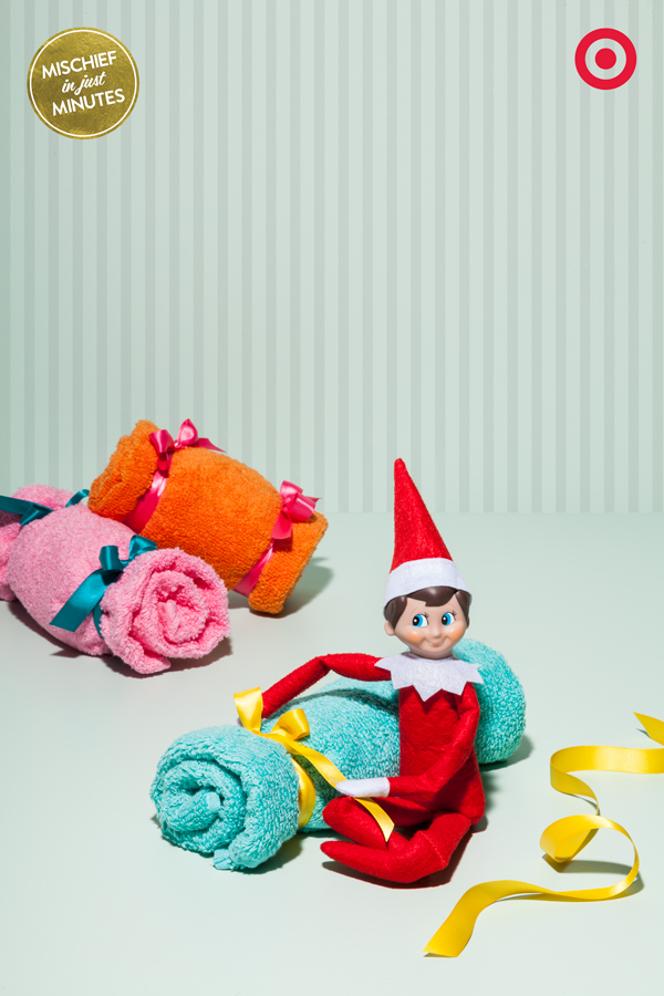 Do towels REALLY belong on the towel bar? Our Elf On The Shelf sure doesn't think so. By simply adding a little ribbon, he's put a new twist on towels and transformed them into oversized plush Christmas candies.