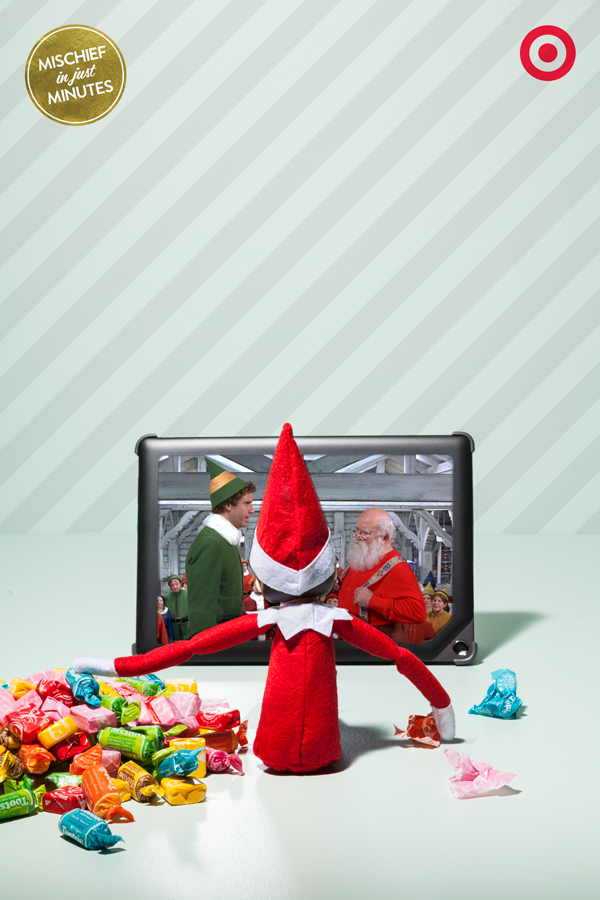 Looks like somebody bought a ticket to the early show! A tablet and a pile of movie snacks is all that Elf On The Shelf needs to enjoy and early-morning-Christmas-movie marathon.