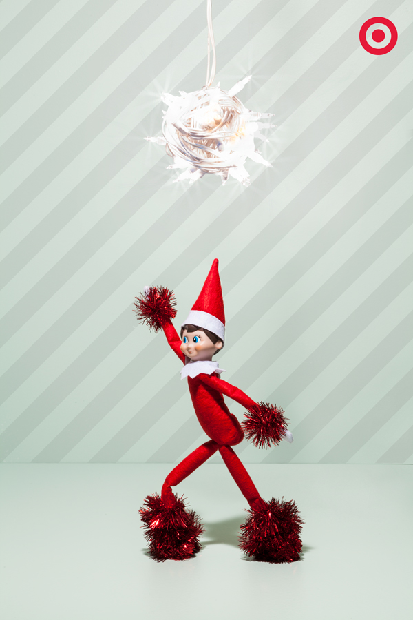 Ever get that urge to dance the night away? Our Elf On The Shelf sure does. First, he build a disco ball out of Christmas lights and then he spiffed up his dance-floor wardrobe with pom-pom gloves and boots. If your elf's feeling a little tired, you can always help prop him up with craft supplies like popsicle sticks or pipe cleaners.