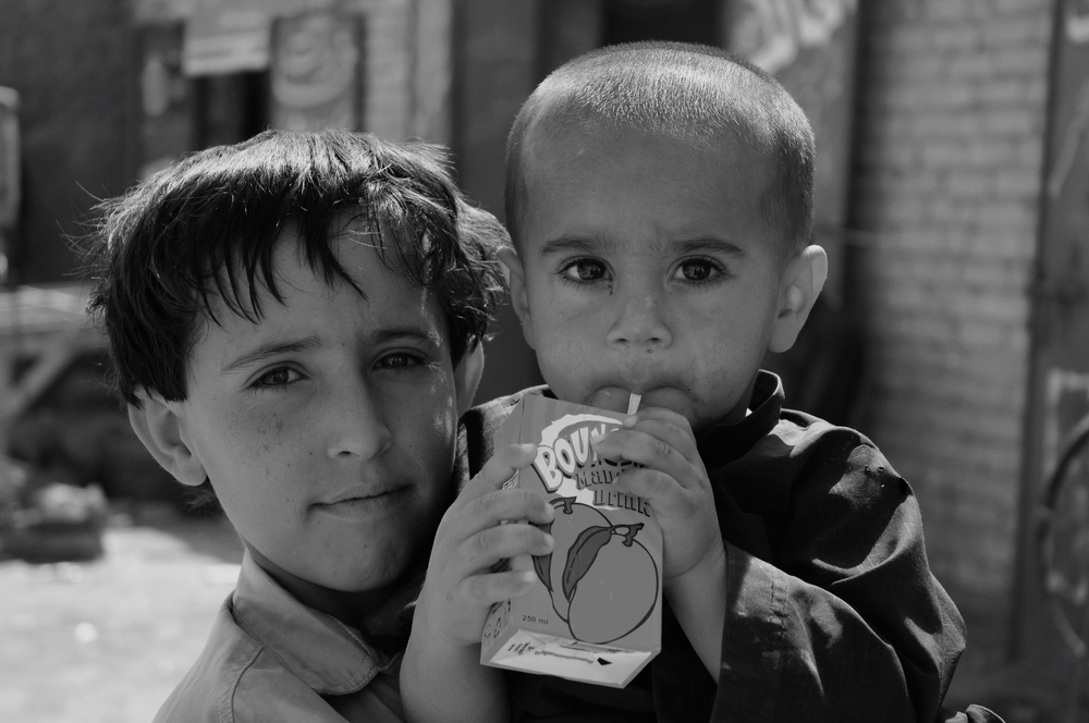 Boy with brother, Dalbandin, Pakistan