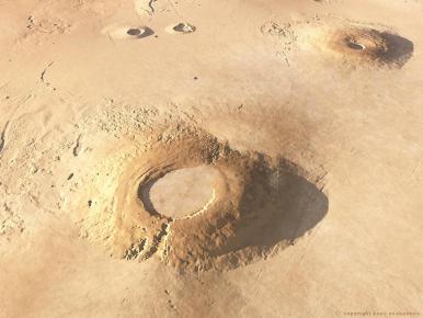 Arsia Mons et Pavonis Mons, les volcans du système occidental de Tharsis, où sera installé le premier ascenseur spatial martien.
