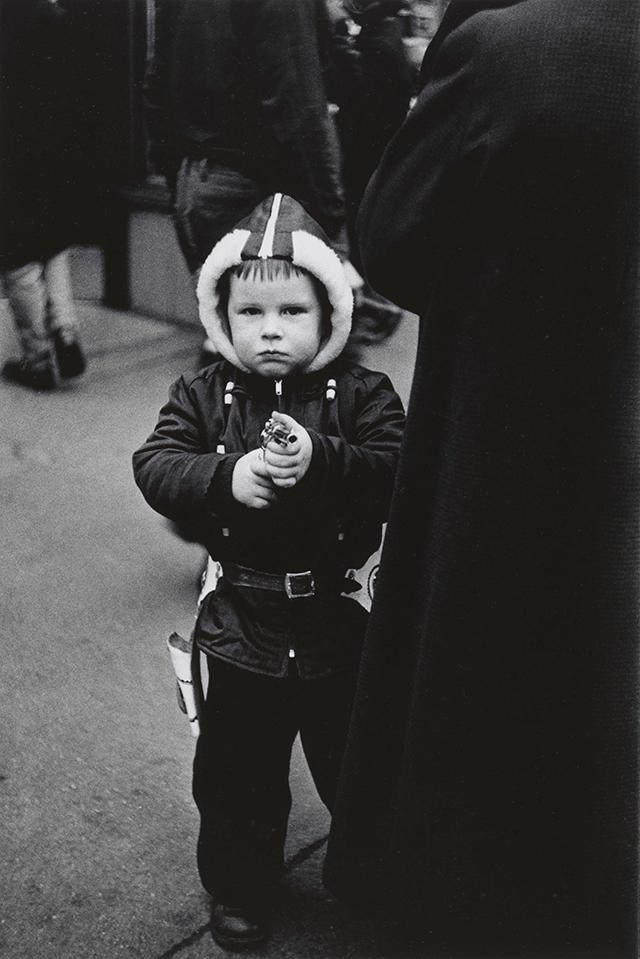 Kid in a hooded jacket aiming a gun N.Y.C. 1957