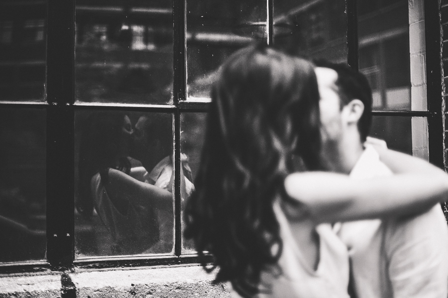 At the end of an eventful engagement session that saw torrential downpours and an inadvertently donated umbrella, Juan and Daniella ended up in front of this wonderful window.  This was the last frame of our session and by far my favourite!