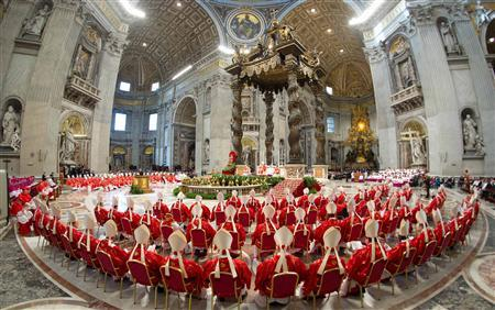Cardinals attend a mass in St. Peter's Basilica, in a picture released by Osservatore Romano at the Vatican March 12, 2013. CREDIT: REUTERS/OSSERVATORE ROMANO