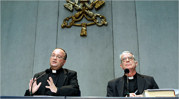 Monsignor Charles Scicluna, the Vatican's sex crimes prosecutor, left, and Vatican spokesman Rev. Federico Lombardi discussed the new set of norms issued on Thursday to respond to the worldwide clerical abuse scandal (Andrew Medichini/Associated Press)