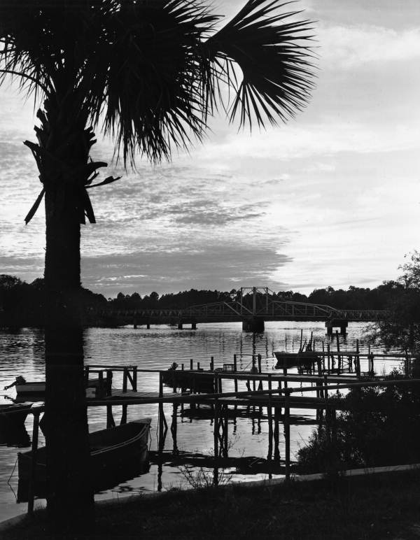 View looking past docks toward swing bridge on the Steinhatchee River